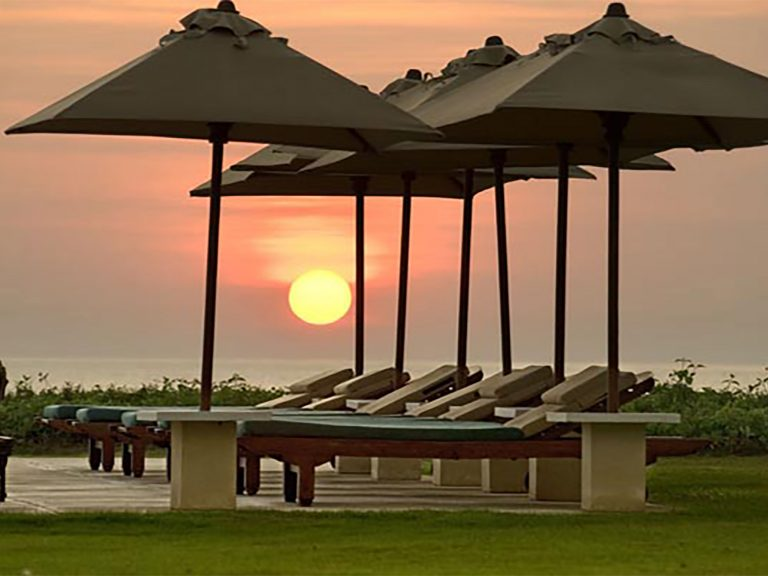 18. Atas Ombak - Sunset and umbrellas